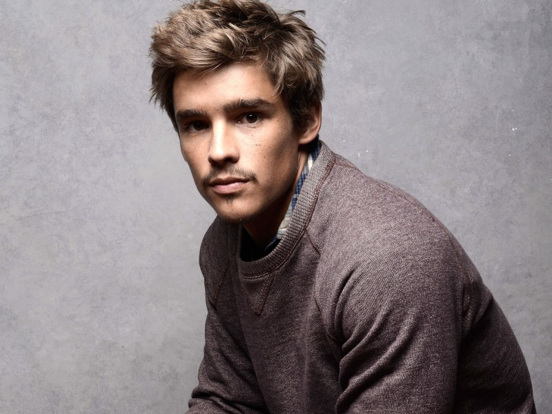 PARK CITY, UT - JANUARY 20:  Actor Brenton Thwaites poses for a portrait during the 2014 Sundance Film Festival at the WireImage Portrait Studio at the Village At The Lift Presented By McDonald's McCafe on January 20, 2014 in Park City, Utah.  (Photo by Jeff Vespa/WireImage)